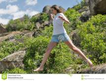 Young Fitness Woman Running Barefoot Mountain Rocks