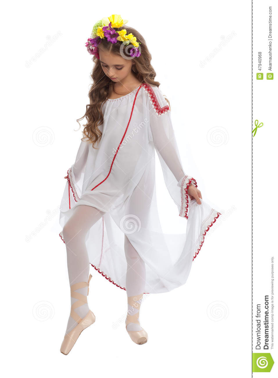 Young Girl In Ballet Shoes And Long White Dress Stock