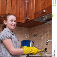 Kitchen Sink Styles Red Cherry Cabinets Young Girl Cleaning Dishes Stock Photography - Image: 18138622