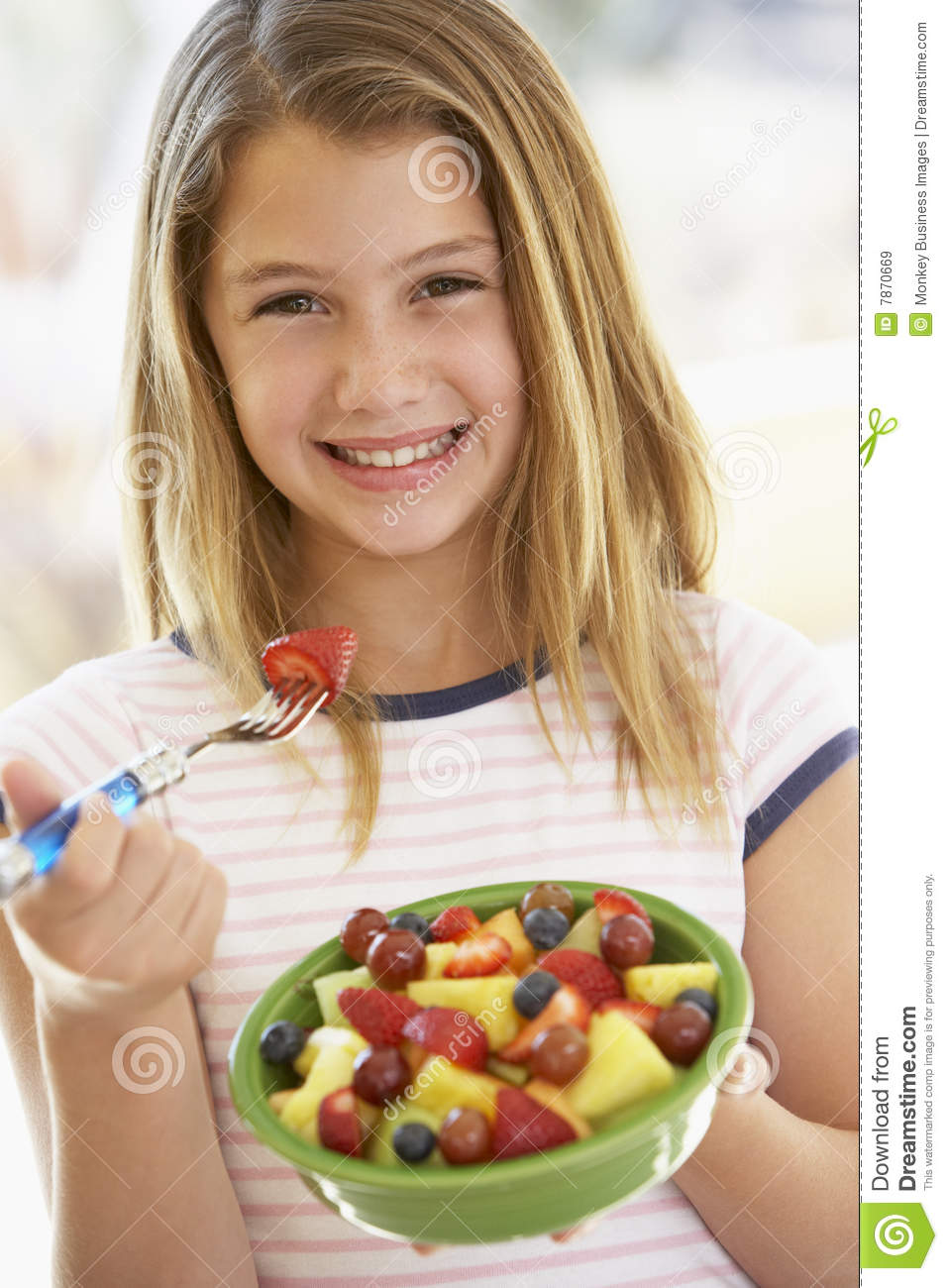 Young Girl Eating Fresh Fruit Salad Royalty Free Stock