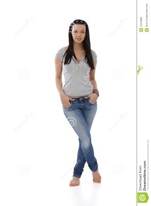 Young Girl In Jeans And T-shirt Standing Barefoot Stock
