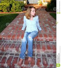 Young Girl Sits Porch Stock - 7473943