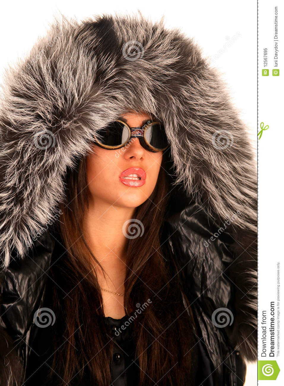 The Young Girl In Sunglasses And A Fur Hood Royalty Free