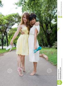 Young Girls Walking Barefoot In Park Royalty Free