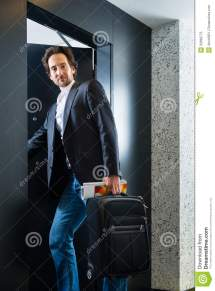Young Guest With Luggage Entering Hotel Room Stock