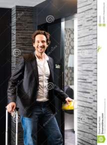 Young Guest With Luggage Entering Hotel Room Royalty Free
