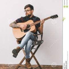 Guitar Playing Chair Comfortable Desk Young Guitarist Hipster At Home With On The Full Body Male Indoors Sitting Thinking Portrait