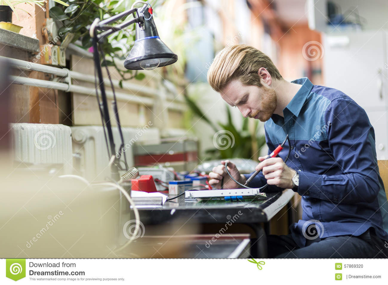 Young Handsome Man Soldering A Circuit Board Stock Photo  Image 57869320