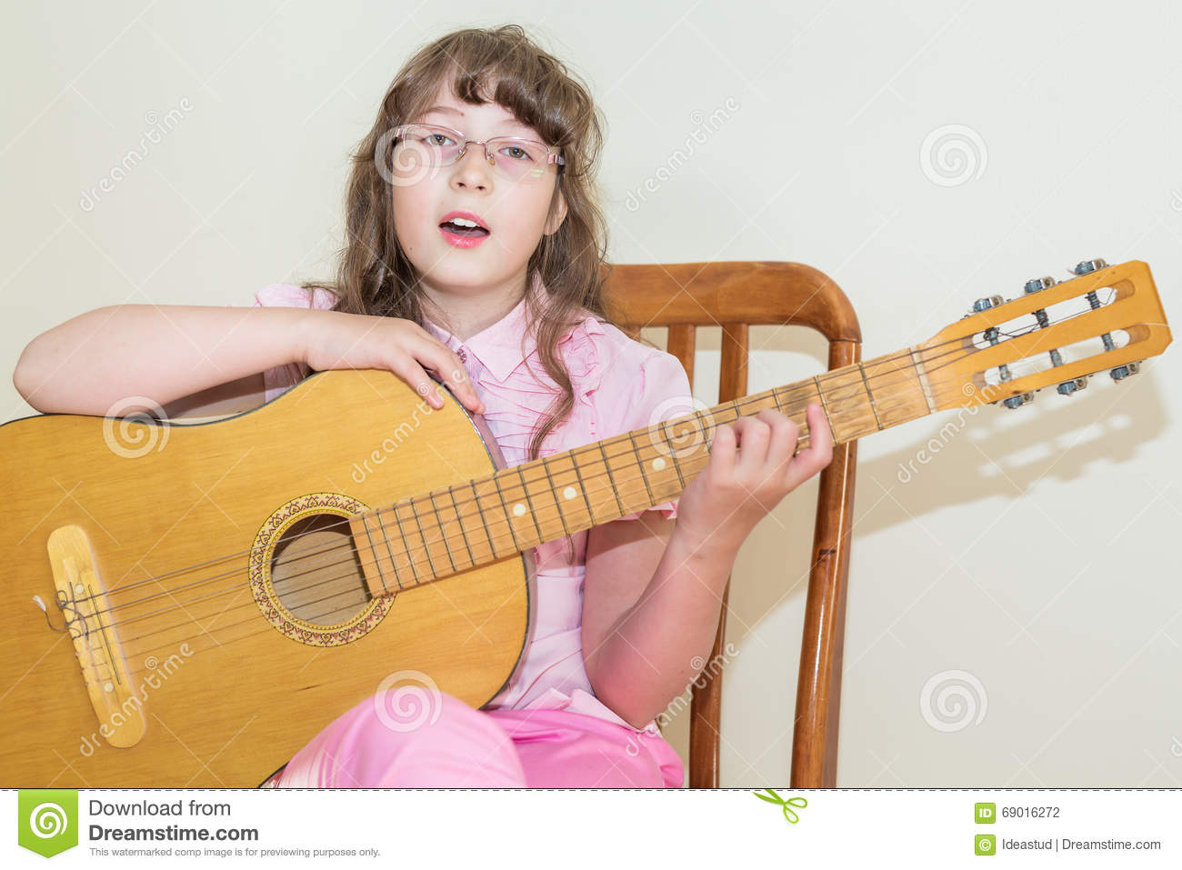 guitar playing chair accent set girl an acoustic closeup royalty free stock