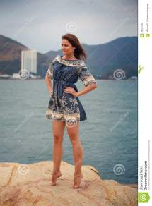 Young Long-legged Girl Barefoot Stands Tiptoe Sea