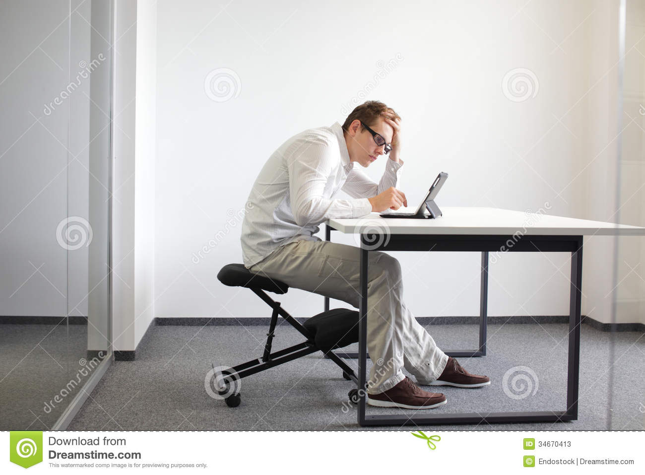 sitting posture on chair in office grey covers wedding young man is bent over his tablet bad at