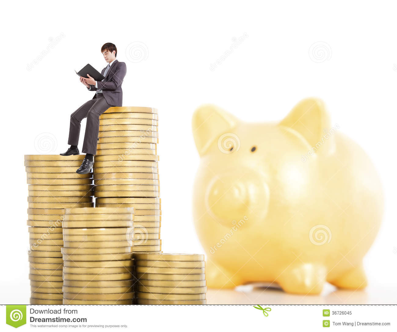 Young Man Counting Coin In Piggy Bank Stock Image