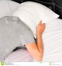 Young Man Face Down In Bed Covering His Head With A Pillow ...