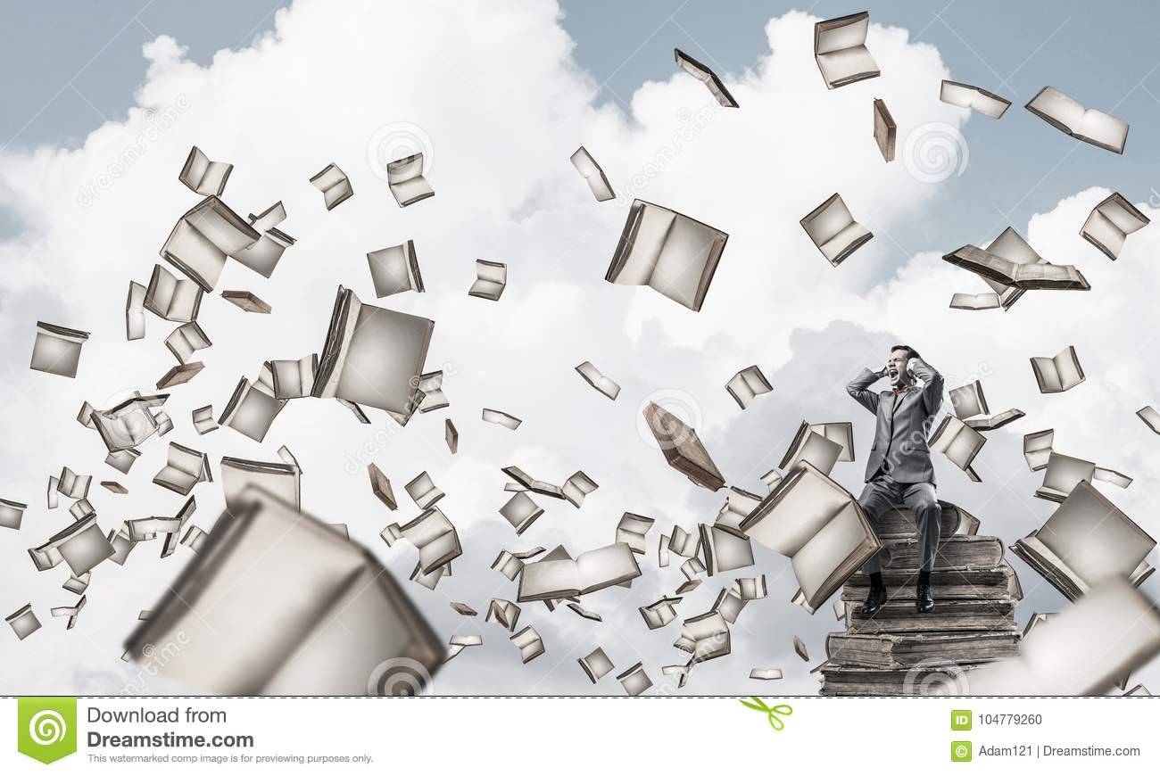 hight resolution of young man on pile of books dont want to hear anything