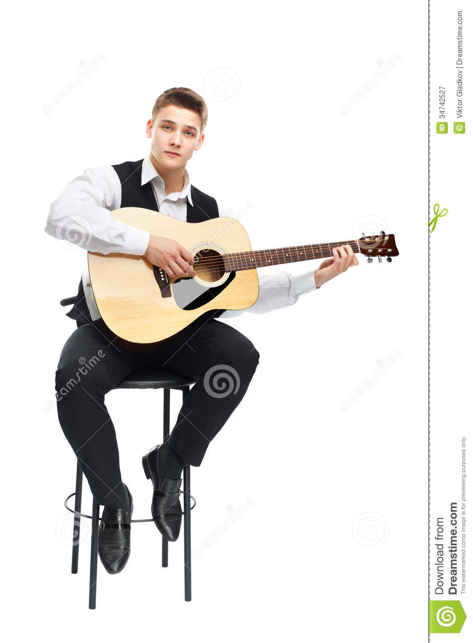 classical guitar chair steelcase leap young man playing on acoustic stock image - image: 34742527