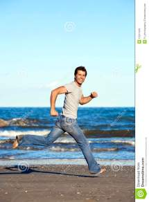 Young Man Running Barefoot Beach Royalty Free Stock