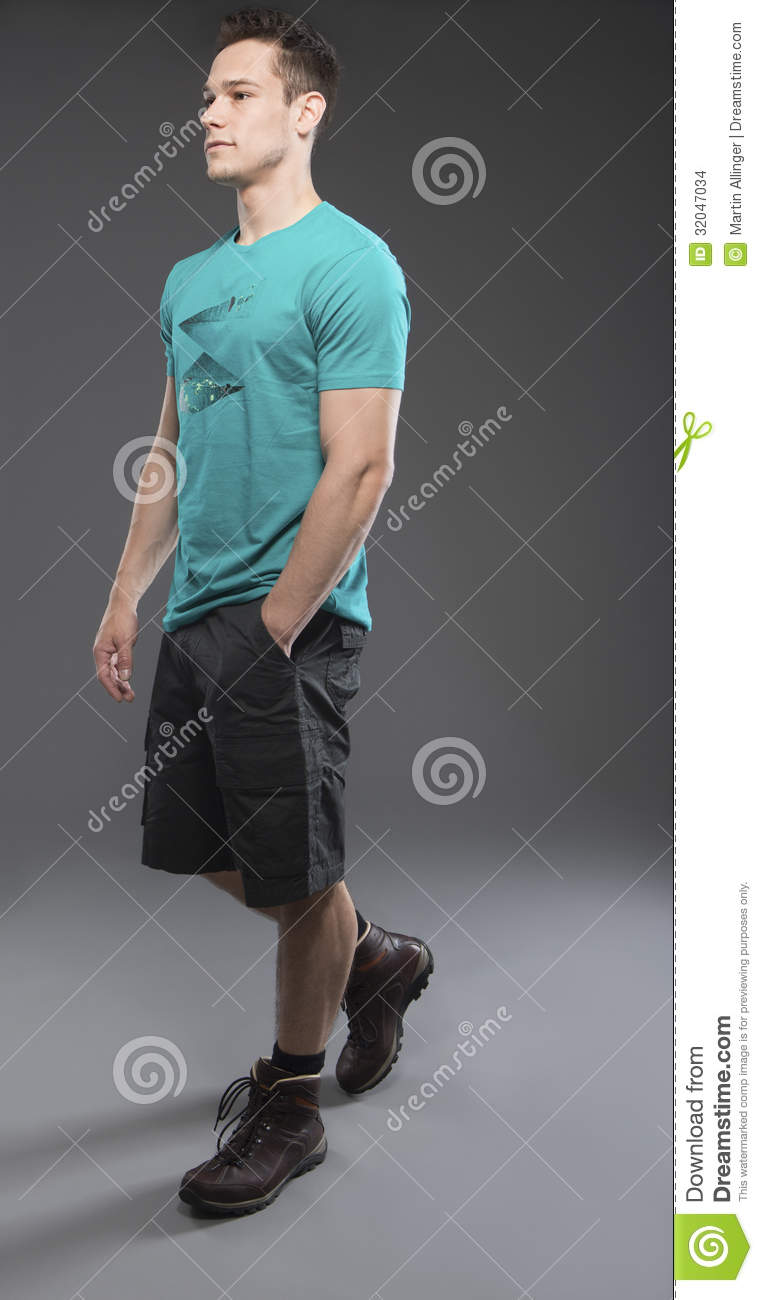 Young Man Walking In Shorts Stock Images  Image 32047034