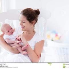 Infant Rocking Chair Target Young Mother And Newborn Baby In White Bedroom Stock Photo - Image: 59264909