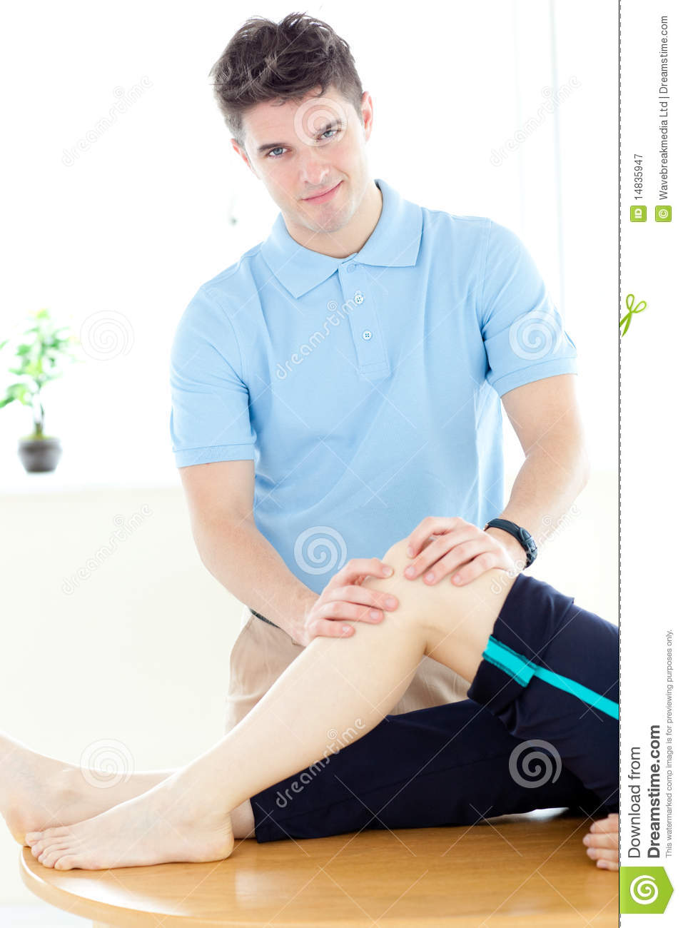 Young Physical Therapist Giving A Leg Massage Stock Image
