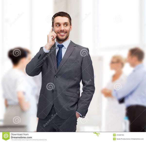 Young Smiling Businessman With Smartphone Stock