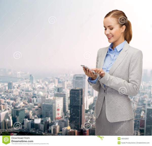 Young Smiling Businesswoman With Smartphone Stock