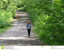 Young Woman Barefoot Forest Road Stock