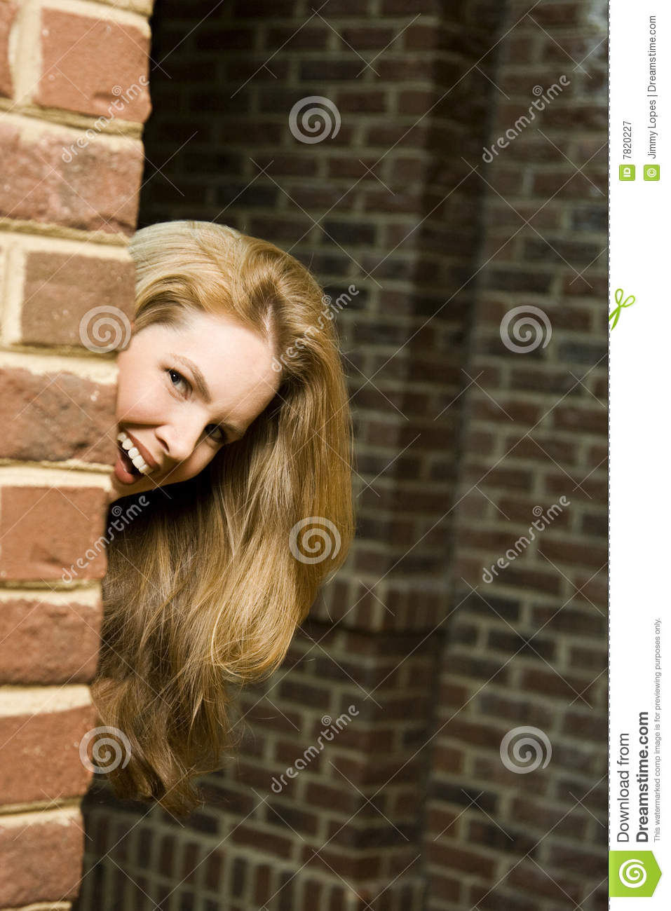 Young Woman Hiding Around Corner Royalty Free Stock