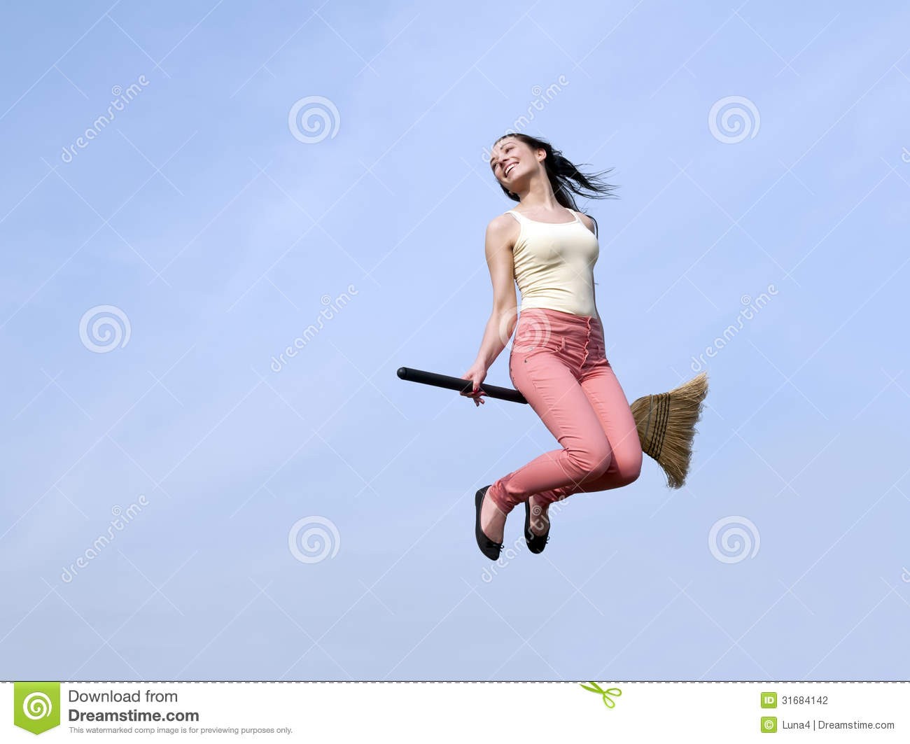 young woman riding broom