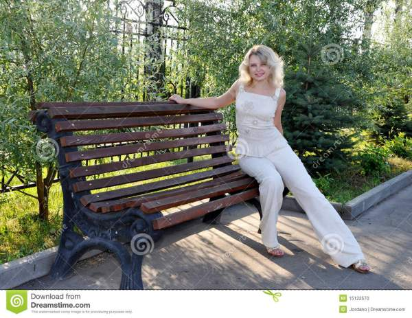 Young Woman Sitting Bench Stock - 15122570