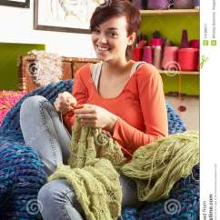 Woman Sitting In Chair Massage With Heat Young Knitting Stock Image - Image: 14188517
