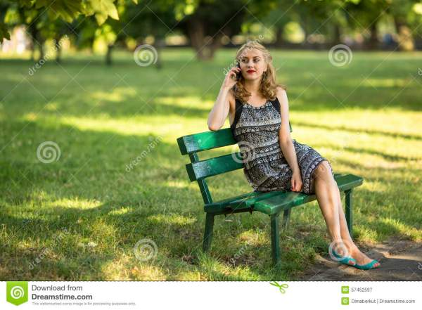 Young Woman Sitting Park Bench Talking Cell