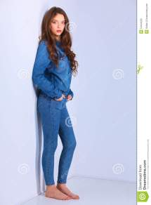Young Woman Standing Barefoot Wall Stock