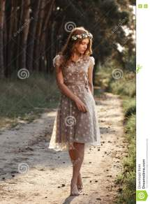 Young Woman In Wreath Walking Forest Barefoot Stock