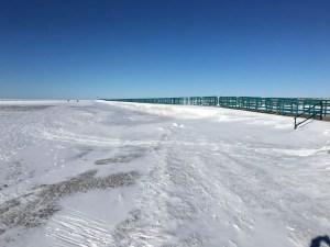 Frozen Caseville Breakwall with Blue Sky