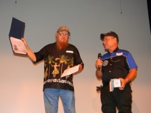 Mickey jones received an honorary certificate of membership to the VMMC from harry Fisher onstage after the screening