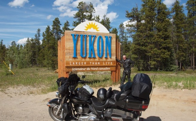 The author entering the Yukon Territory on the Alaska Highway at Watson Lake