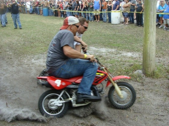 T.J. takes the outside lane for the pass during the minibike races