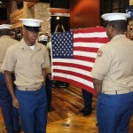 University of Memphis ROTC members present the flag