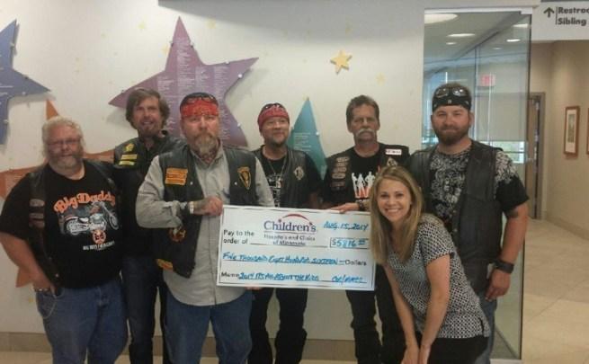 Club members present a $5,816 check to Children's Hospital representatives