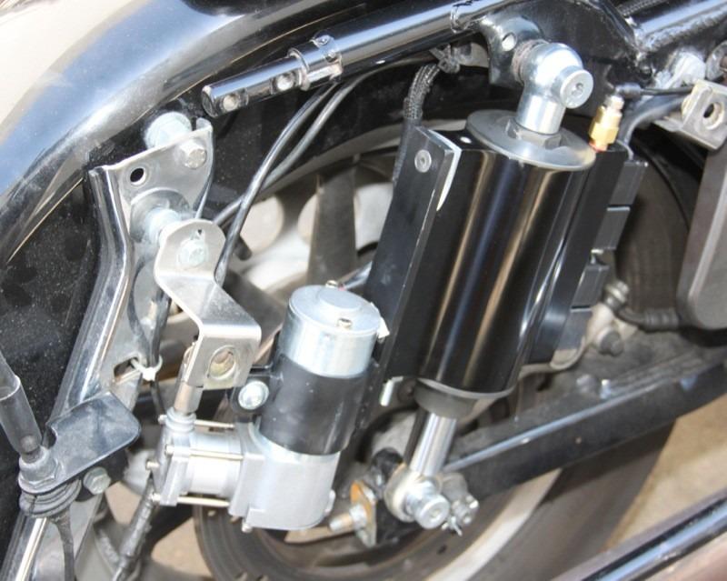 Bagger shock with compressor