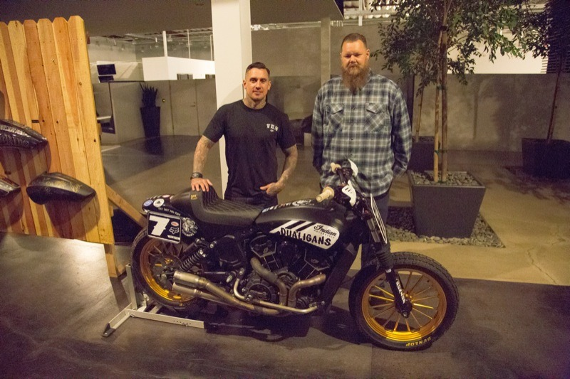 Carey Hart and his Good Ride partner Big B with one of the many cool Indian motorcycles on display at the industry party Thursday night