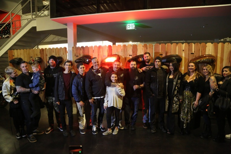 Carey Hart, along with his wife Pink and daughter Willow join friends and contributors for a group photo towards the end of the evening
