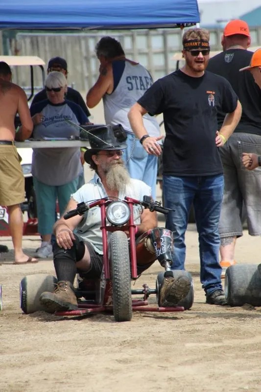 Herold Renyolds that is known for competing in the barrel races (and doing quite well with one prosthetic leg) gearing up for a round of drift trike racing