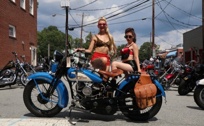 A pair of Burlesque dancers take a break to pose on my 1933 Harley-Davidson VL while handing out flyers during the Bull City Rumble