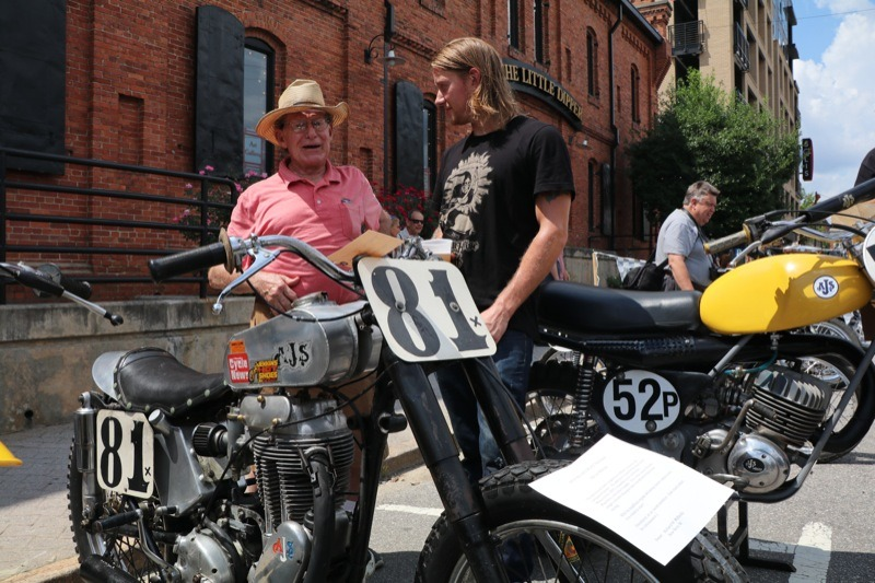 Ryan Tickle listening to this old timer describe his AJS powered race bike