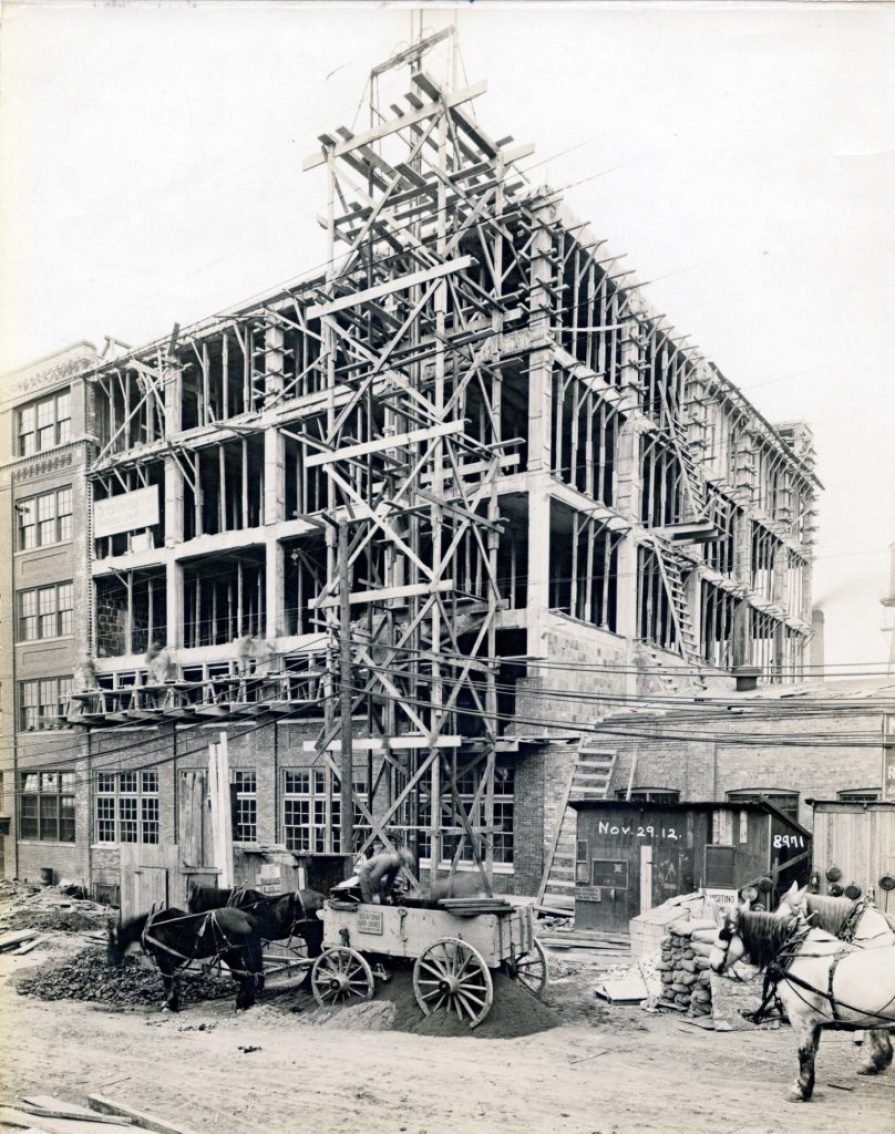 Harley-Davidson's Juneau Ave. headquarters nearing completion on November 29, 1912. Them horses look hungry to us.