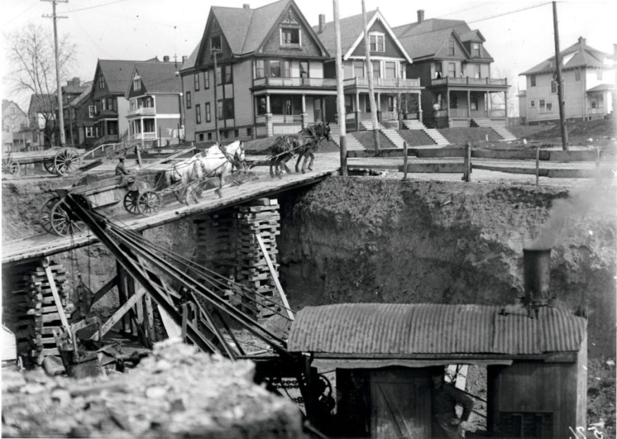 Excavation work and a makeshift bridge for the factory addition at 37th and Juneau, circa 1912.