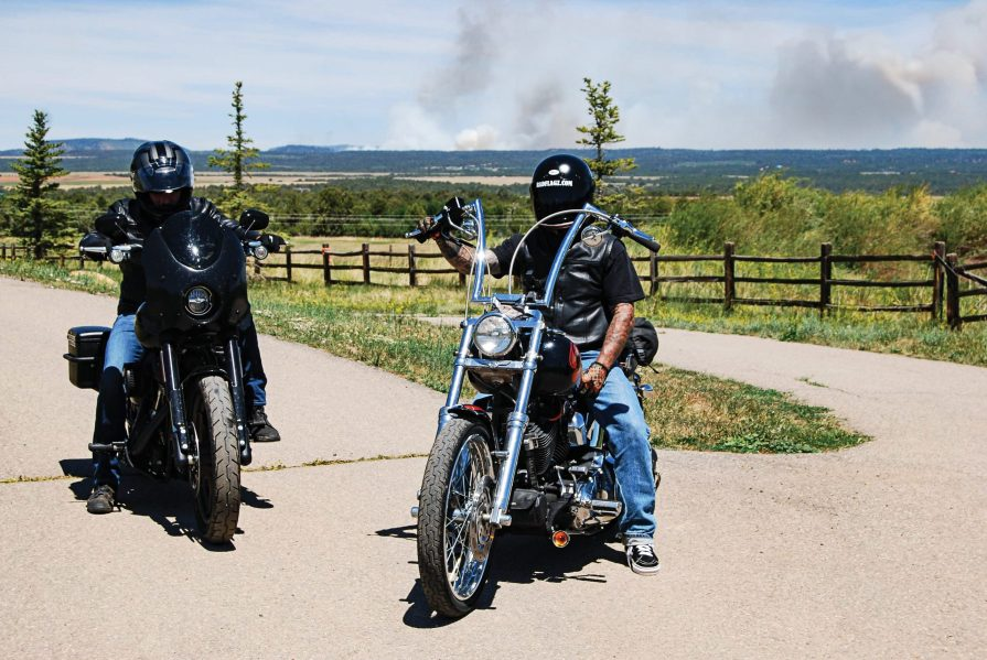 Dave Roe from V-Twin Visionary on the 2020 Low Rider S and Kent Prentiss of Radflagz on his custom chopper outside of Durango, Colorado. A sign of the times with a forest fire burning in the background.