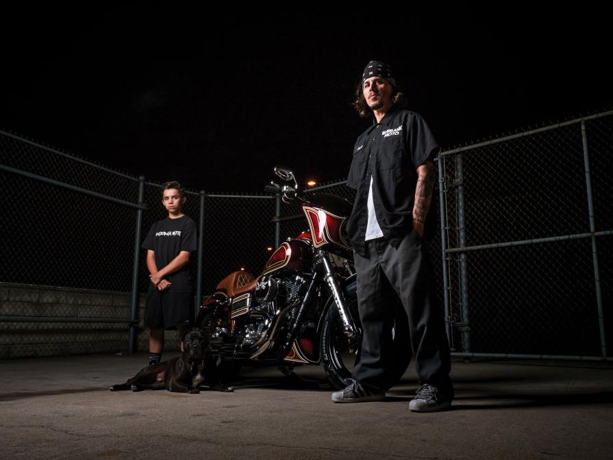 "Jerry Turner II, Jerry Turner III and shop dog, Archie, pose during a publicity shoot in front of our Dyna build, ""El Jefe."""