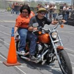 Irene and Paul Salinas, Magic Valley Rider founding members and field event coordinators, show competitors how 'Stand the Can' is properly done